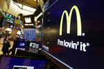 The logo for McDonald's appears above a trading post on the floor of the New York Stock Exchange, Monday, Nov. 4, 2019. McDonald's sank 2.3% after its CEO was ousted after violating company policy by having a relationship with an employee. (AP Photo/Richard Drew)