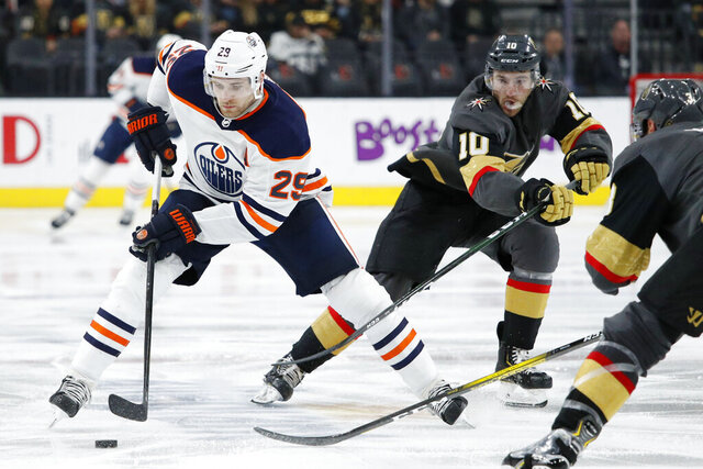 FILE - In this Feb. 26, 2020, file photo, Edmonton Oilers center Leon Draisaitl (29) skates against the Vegas Golden Knights during the third period of an NHL hockey game in Las Vegas. Draisaitl has won the Hart Trophy as MVP after leading the NHL in scoring. (AP Photo/John Locher, File)
