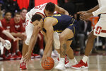 California guard Matt Bradley, front, reaches for the ball in front of Stanford forward Oscar da Silva during the first half of an NCAA college basketball game in Stanford, Calif., Thursday, Jan. 2, 2020. (AP Photo/Jeff Chiu)