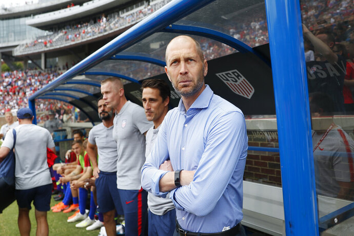 FILE - In this June 9, 2019, file photo, United States head coach Gregg Berhalter stands on the sideline before the first half of an international friendly soccer match against Venezuela in Cincinnati. A day after last week's deadly riot in the Capitol by a pro-Trump mob, players from the U.S. soccer team gathered in Bradenton, Fla., and considered what they could do to set a positive example for a shaken country. Berhalter said he has not yet spoken to players about the events in Washington. (AP Photo/John Minchillo, File)