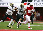 FILE - In this Sept. 8, 2018, file photo, Nebraska running back Greg Bell (25) runs away from Colorado defensive back Dustin Johnson (26) and defensive back Delrick Abrams Jr. (1) during the first half of an NCAA college football game in Lincoln, Neb. The 18-point underdog Cornhuskers, averaging 258 yards per game on the ground, need their three-man rotation of Greg Bell, Maurice Washington and Devine Ozigbo to produce if they are going to pull the upset against Michigan.(AP Photo/Nati Harnik, File)