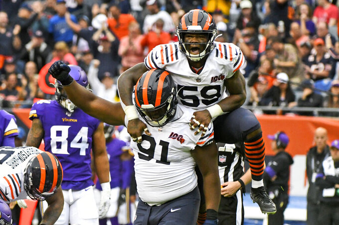 Chicago Bears' Danny Trevathan (59) and Eddie Goldman (91) celebrate a fumble by Minnesota Vikings quarterback Kirk Cousins and Bears recovery during the second half of an NFL football game Sunday, Sept. 29, 2019, in Chicago. (AP Photo/Matt Marton)