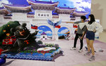 Visitors react to the 3-D painting featuring Chiang Kai-shek memorial hall at the 3-D View Taiwan Exhibition in Taipei, Taiwan, Sunday, Sept. 27, 2020. (AP Photo/Chiang Ying-ying)