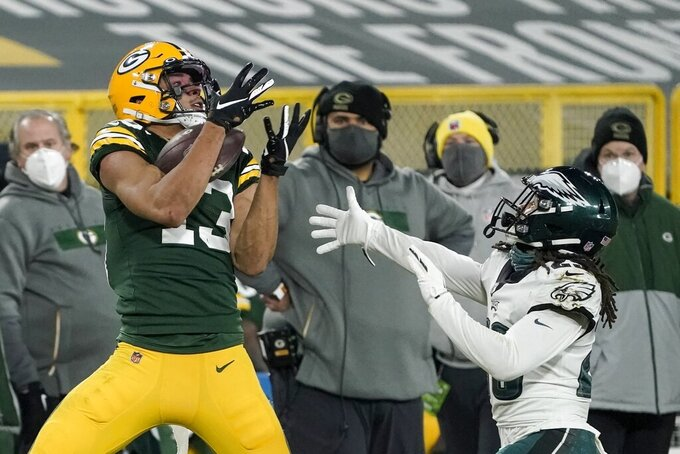 Green Bay Packers' Allen Lazard catches a pass in front of Philadelphia Eagles' Avonte Maddox during the second half of an NFL football game Sunday, Dec. 6, 2020, in Green Bay, Wis. (AP Photo/Morry Gash)