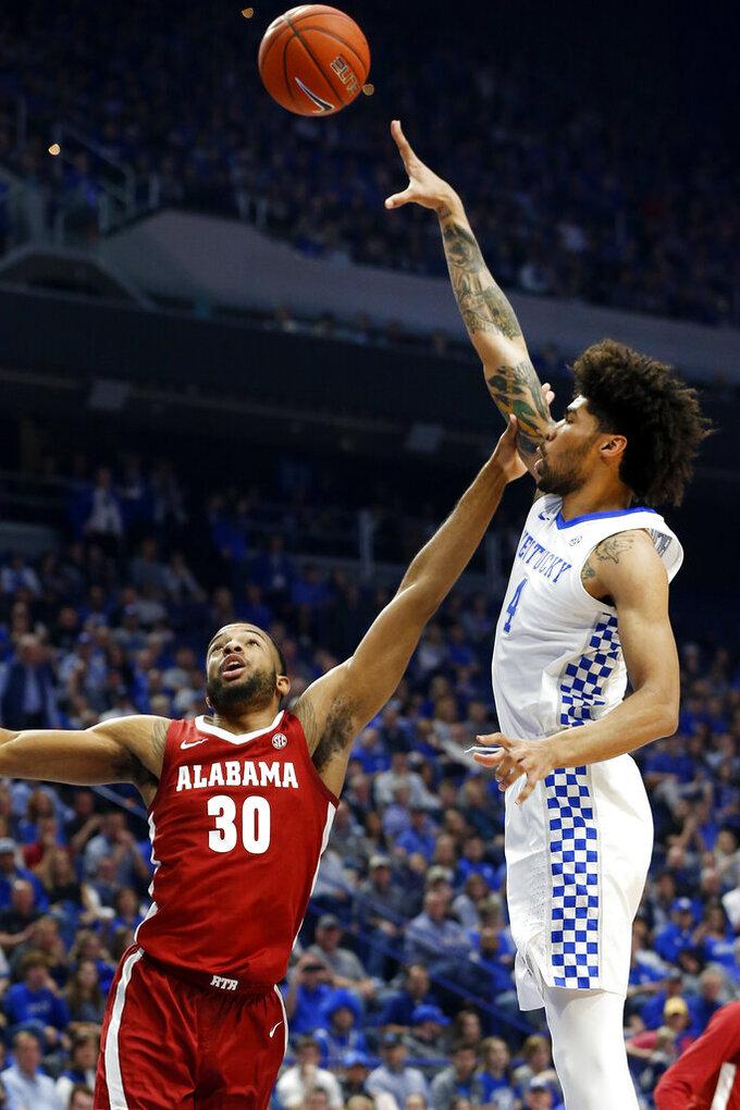 Kentucky's Nick Richards, right, shoots over Alabama's Galin Smith (30) during the first half of an NCAA college basketball game in Lexington, Ky., Saturday, Jan 11, 2020. (AP Photo/James Crisp)