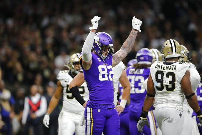 Minnesota Vikings tight end Kyle Rudolph (82) celebrates a touchdown by Dalvin Cook in the second half of an NFL wild-card playoff football game against the New Orleans Saints, Sunday, Jan. 5, 2020, in New Orleans. (AP Photo/Brett Duke)