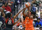 Connecticut Sun's Jonquel Jones, right, grabs a rebound in front of Washington Mystics' LaToya Sanders during the first half in Game 3 of basketball's WNBA Finals, Sunday, Oct. 6, 2019, in Uncasville, Conn. (AP Photo/Jessica Hill)