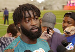 FILE - In this Tuesday, June 4, 2019, file photo, Miami Dolphins free safety Reshad Jones speaks to the news media at the team's NFL football training facility in Davie, Fla. Former Miami Dolphins Pro Bowl safety Reshad Jones was arrested early Wednesday, Nov. 18, 2020, in Davie Fla., on a charge of carrying a concealed firearm. (AP Photo/Lynne Sladky, File)