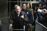 Harvey Weinstein gestures as he walks by reporters as he leaves a Manhattan courtroom after attending jury selection for his trial on rape and sexual assault charges, Friday, Jan. 17, 2020 in New York. (AP Photo/Mark Lennihan)