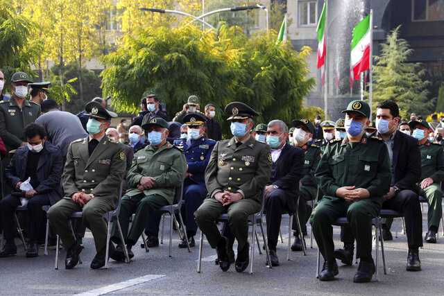 In this photo released by the official website of the Iranian Defense Ministry, military military commanders attend a funeral ceremony of Mohsen Fakhrizadeh, a scientist who was killed on Friday, in a funeral ceremony in Tehran, Iran, Monday, Nov. 30, 2020. Iran held the funeral Monday for the slain scientist who founded its military nuclear program two decades ago, with the Islamic Republic's defense minister vowing to continue the man's work