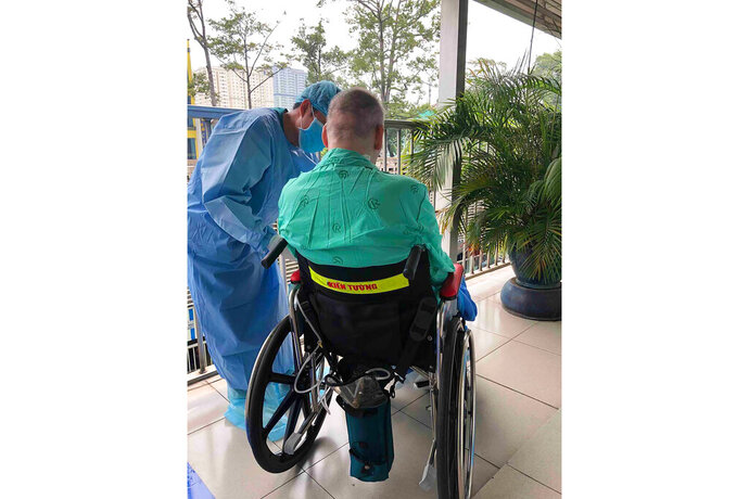In this photo provided by Cho Ray Hospital, a doctor attends to