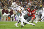 Louisville linebacker Boosie Whitlow (49) sacks Mississippi State quarterback Tommy Stevens (7) for a 10-yard loss in the second half of the Music City Bowl NCAA college football game Monday, Dec. 30, 2019, in Nashville, Tenn. (AP Photo/Mark Humphrey)