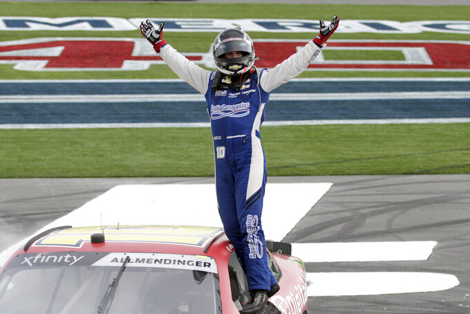 AJ Allmendinger celebrates after winning a NASCAR Xfinity Series auto race at Charlotte Motor Speedway in Concord, N.C., Saturday, Sept. 28, 2019. (AP Photo/Russell Norris)