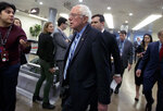 Sen. Bernie Sanders, I-Vt., walks to the Senate chamber for the impeachment trial of President Donald Trump on Capitol Hill in Washington, Wednesday, Jan. 22, 2020. (AP Photo/Jose Luis Magana)