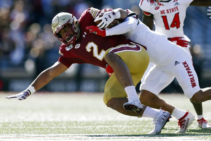 North Carolina State safety Tanner Ingle, right, tackles Boston College running back AJ Dillon (2) during the first half of an NCAA college football game in Boston, Saturday, Oct. 19, 2019. (AP Photo/Michael Dwyer)