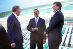 Tennessee Gov. Bill Lee, center, talks with Ford Executive Chairman Bill Ford, left, and Jim Farley, Ford president and CEO, right, after a presentation on the planned factory to build electric F-Series trucks and the batteries to power future electric Ford and Lincoln vehicles Tuesday, Sept. 28, 2021, in Memphis, Tenn. The plant in Tennessee is to be built near Stanton, Tenn. (AP Photo/Mark Humphrey)
