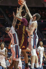 Minnesota forward Jordan Murphy (3) tries to shoot between Illinois guard Aaron Jordan, left, and forward Giorgi Bezhanishvili (15) during the second half of an NCAA college basketball game in Champaign, Ill., Wednesday, Jan. 16, 2019. (AP Photo/Rick Danzl)