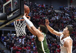 Colorado State guard David Roddy shoots past the defense of San Diego State forward Yanni Wetzell, right, during the first half of an NCAA college basketball game Tuesday, Feb. 25, 2020, in San Diego. (AP Photo/Denis Poroy)