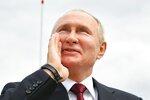 Russian President Vladimir Putin shouts to spectators as he leaves the Navy Day parade in St. Petersburg, Russia, Sunday, July 25, 2021. (Alexei Nikolsky, Sputnik, Kremlin Pool Photo via AP)