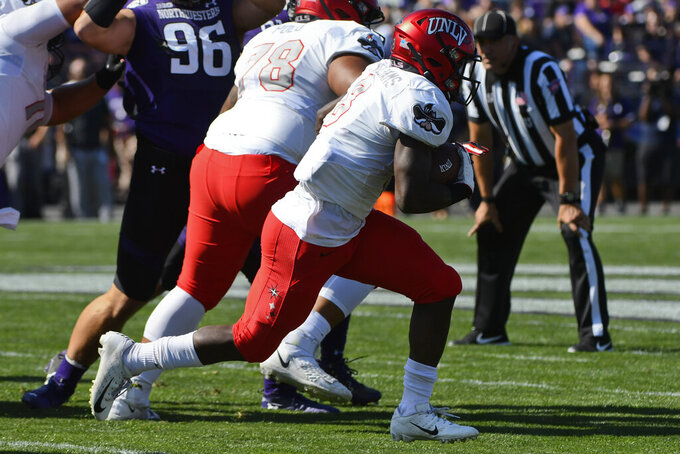 UNLV running back Charles Williams (8) runs for a touchdown against Northwestern during the first half of an NCAA college football game, Saturday, Sept. 14, 2019, in Evanston, Ill. (AP Photo/Matt Marton)