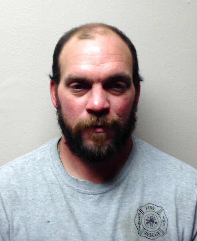 Thomas Launderville, is seen in  photo provided by the  Greene County (Iowa) Jail. Launderville has been accused of being drunk while driving an ambulance and taking a patient to a hospital. Greene has been accused of being drunk while driving an ambulance and taking a patient to a hospital Friday, Nov. 1, 2019. Launderville has since been dismissed as Grand Junction's fire chief. (Greene County (Iowa) Jail  via AP)