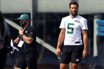 FILE - In this Saturday, Aug. 22, 2020, file photo, New York Jets quarterback Joe Flacco (5) during a practice at the NFL football team's training camp in Florham Park, N.J. Flacco passed his physical and will start the season on the New York Jets' active roster as one of Sam Darnold's backups.  (AP Photo/Adam Hunger, File)