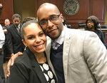 Moss Point Mayor Mario King and his wife, Natasha King, pose for a photograph on Feb. 6, 2018, at City Hall in Moss Point, Miss. The couple plead guilty Wednesday, Feb. 24, 2021, in federal court to a charge of conspiring to defraud the federal government. Prosecutors said the mayor, who resigned Wednesday, and his wife had raised money for mental health programs in schools but spent it on themselves for expenses that included car payments and the purchase of a pet dog. (John Fitzhugh/The Sun Herald via AP)