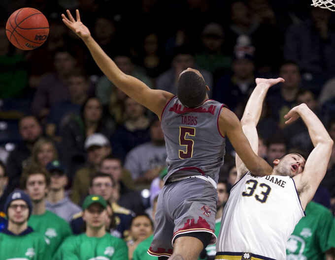 Boston College's Wynston Tabbs (5) has the ball knocked away by Notre Dame's John Mooney (33) during the second half of an NCAA college basketball game Saturday, Jan. 12, 2019, in South Bend, Ind. Notre Dame won 69-66. (AP Photo/Robert Franklin)