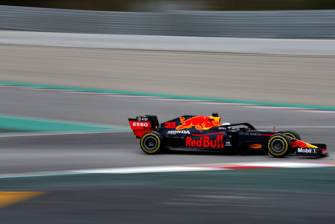 Red Bull driver Max Verstappen of the Netherlands steers his car during the Formula One pre-season testing session at the Barcelona Catalunya racetrack in Montmelo, outside Barcelona, Spain, Friday, Feb. 28, 2020. (AP Photo/Joan Monfort)