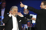 Opera star Placido Domingo performs during a concert in Szeged, Hungary, Wednesday, Aug. 28, 2019. Domingo continued his calendar of European engagements unabated despite allegations of sexual harassment, appearing Wednesday at a concert in southern Hungary to inaugurate a sports complex for a local Catholic diocese.(AP Photo/Laszlo Balogh)