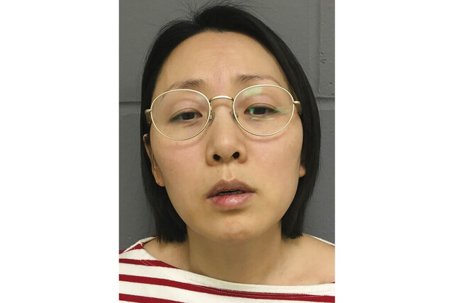 This undated photo provided by the West Des Moines, Iowa Police Department shows Gowun Park. Park was charged with first-degree murder and first-degree kidnapping in the death of her husband, Sung Nam. Police say she bound and gagged her husband for hours, leading to his death. Park was arrested Wednesday, Feb. 19, 2020 at the West Des Moines Police Department.  (West Des Moines Police Department via AP)