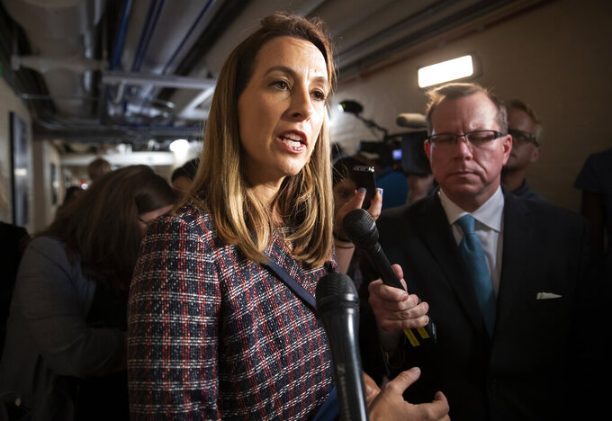 FILE - Rep. Mikie Sherrill, D-N.J., talks to reporters, Tuesday Sept. 24, 2019, on Capitol in Washington. Sherrill will face Republican Rosemary Becchi for New Jersey's 11th Congressional District in the 2020 election. (AP Photo/J. Scott Applewhite, File)