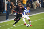 Mexico defenseman Luis Rodriguez, left, and Honduras defenseman Diego Rodriguez compete for the ball during the first half of a CONCACAF Gold Cup soccer match, Saturday, July 24, 2021, in Glendale, Ariz. (AP Photo/Rick Scuteri)