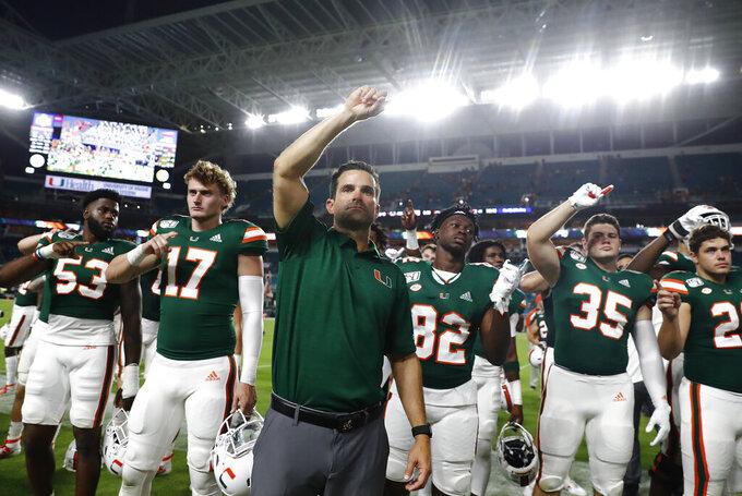 Miami head coach Manny Diaz celebrates after an NCAA college football game against Central Michigan, Saturday, Sept. 21, 2019, in Miami Gardens, Fla. Miami won 17-12. (AP Photo/Brynn Anderson)