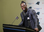 Carolina Panthers NFL football player Gerald McCoy answers a question during a news conference in Charlotte, N.C., Tuesday, June 4, 2019. After nine productive seasons with the Tampa Bay Buccaneers, the six-time Pro Bowl and three-time All-Pro defensive tackle McCoy signed with the Panthers. (AP Photo/Chuck Burton)