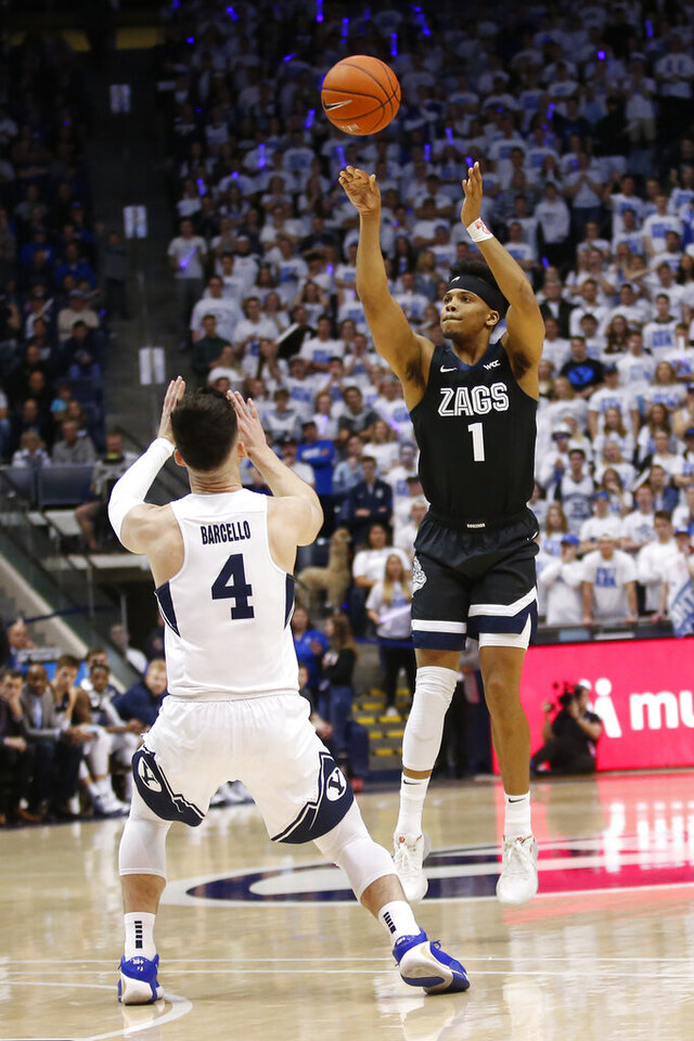 Gonzaga guard Admon Gilder (1) shoots as BYU guard Alex Barcello (4) defends in the first half of an NCAA college basketball game Saturday, Feb. 22, 2020, in Provo, Utah. (AP Photo/Rick Bowmer)