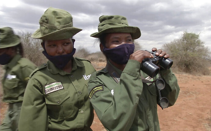 In this image made from video, Purity Amleset, 24, right, and other female wildlife rangers from