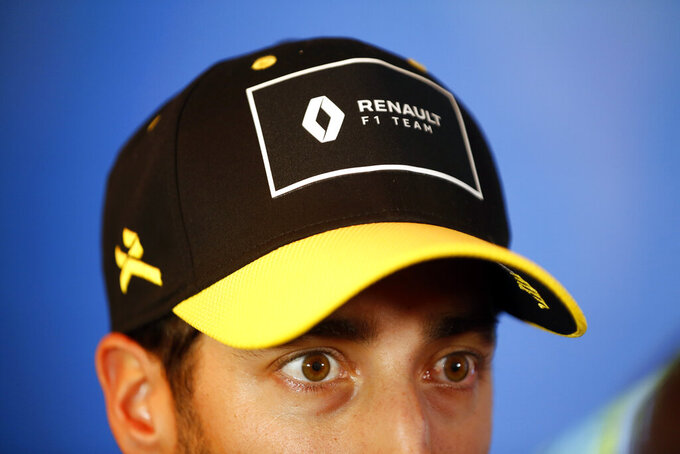 Renault drivers Daniel Ricciardo of Australia answers media after a press conference, in Paris, Wednesday, Feb. 12, 2020. (AP Photo/Thibault Camus)