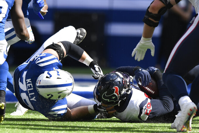 Houston Texans outside linebacker Whitney Mercilus (59) recovers a fumble in front of Indianapolis Colts' Ryan Kelly (78) during the first half of an NFL football game, Sunday, Oct. 20, 2019, in Indianapolis. (AP Photo/Doug McSchooler)