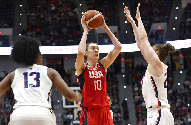 United States' Breanna Stewart, center, shoots between Connecticut's Christyn Williams, left, and Connecticut's Anna Makurat, right, in the second half of an exhibition basketball game, Monday, Jan. 27, 2020, in Hartford, Conn. (AP Photo/Jessica Hill)