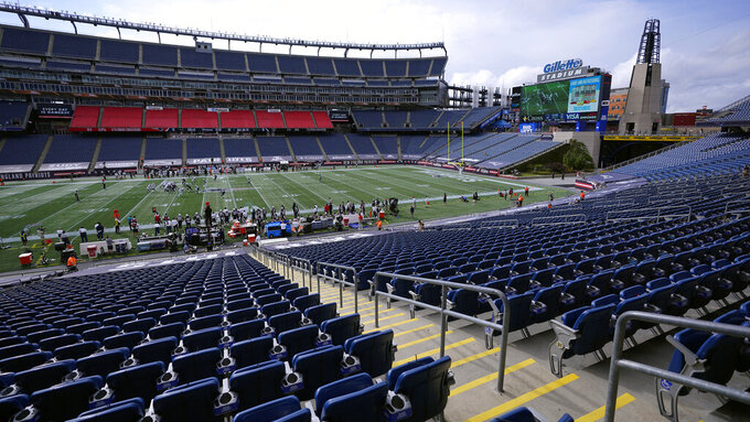 The New England Patriots and the Las Vegas Raiders play in an empty Gillette Stadium due to the coronavirus pandemic in the second half of an NFL football game, Sunday, Sept. 27, 2020, in Foxborough, Mass. (AP Photo/Charles Krupa)