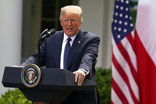 President Donald Trump speaks during a news conference with Polish President Andrzej Duda in the Rose Garden of the White House, Wednesday, June 24, 2020, in Washington. (AP Photo/Evan Vucci)