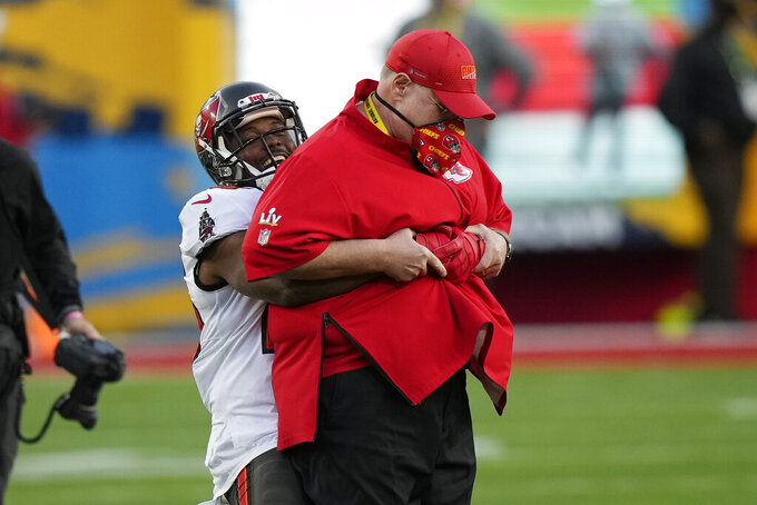 Tampa Bay Buccaneers running back LeSean McCoy picks up Kansas City Chiefs' Andy Reid before the NFL Super Bowl 55 football game between the Kansas City Chiefs and Tampa Bay Buccaneers, Sunday, Feb. 7, 2021, in Tampa, Fla. (AP Photo/David J. Phillip)