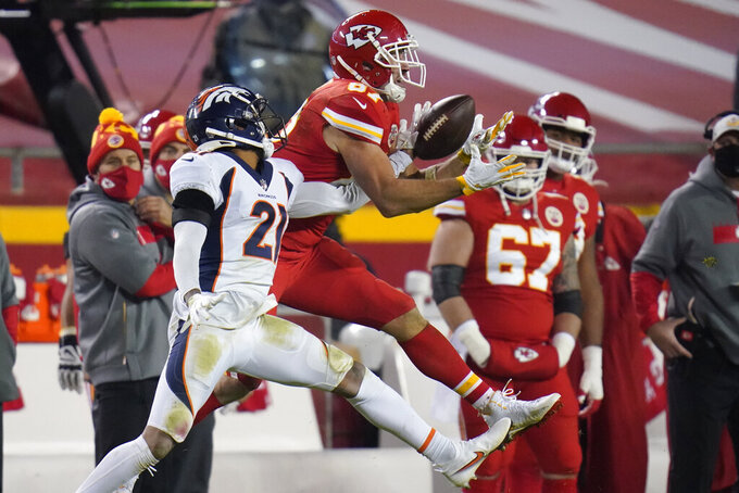 Denver Broncos cornerback A.J. Bouye (21) breaks up a pass intended for Kansas City Chiefs tight end Travis Kelce (87) in the second half of an NFL football game in Kansas City, Mo., Sunday, Dec. 6, 2020. (AP Photo/Jeff Roberson)