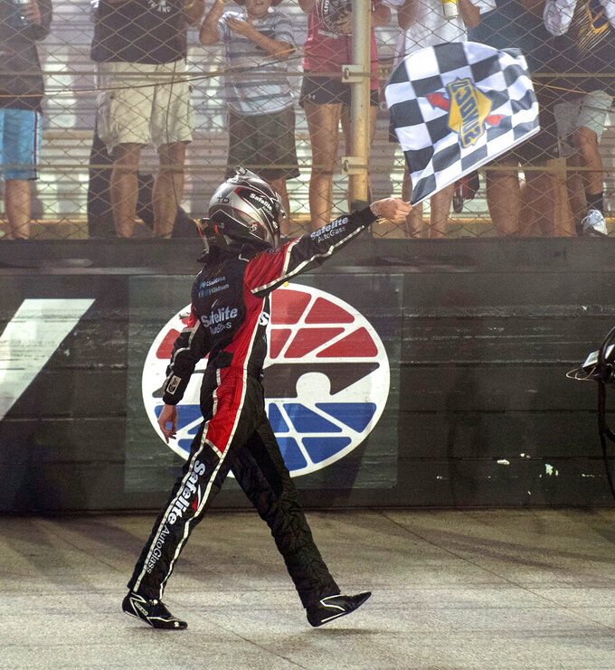 Chandler Smith waves the checkered flag after his win in the NASCAR Truck Series auto race Thursday, Sept. 16, 2021, at Bristol Motor Speedway in Bristol, Tenn. (David Crigger/Bristol Herald Courier via AP)
