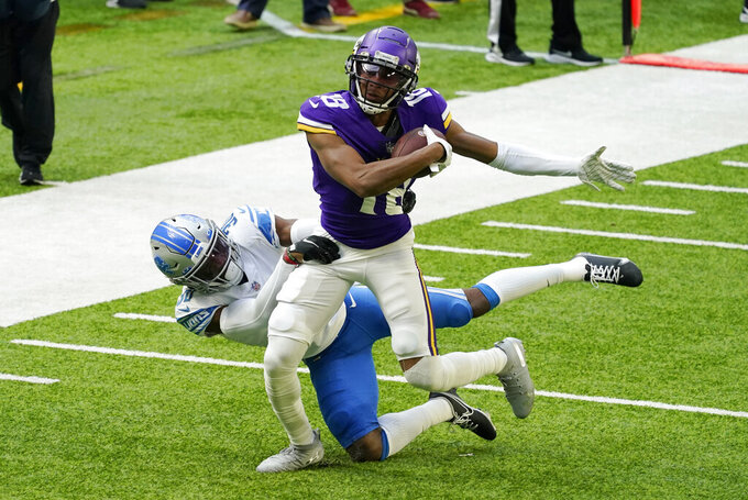 Minnesota Vikings wide receiver Justin Jefferson (18) runs from Detroit Lions cornerback Jeff Okudah after catching a pass during the first half of an NFL football game, Sunday, Nov. 8, 2020, in Minneapolis. (AP Photo/Jim Mone)