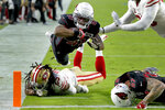 Arizona Cardinals Kenyan Drake (41) scores a touchdown as San Francisco 49ers cornerback Richard Sherman defends during the first half of an NFL football game, Thursday, Oct. 31, 2019, in Glendale, Ariz. (AP Photo/Rick Scuteri)