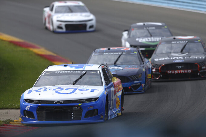 Ricky Stenhouse Jr. leads a group of cars turning to the Esses during a NASCAR Cup Series auto race in Watkins Glen, N.Y., on Sunday, Aug. 8, 2021. (AP Photo/Joshua Bessex)