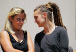 Sea-Watch3 German captain Carola Rackete, right, talks to Sea-Wacht spokesperson Giorgia Linardi as she leaves after being questioned in court in the southern Sicilian town of Agrigento, Italy, Thursday, July 18, 2019. Rackete, who forced a government block docking at an Italian port after rescuing migrants, faces questioning by Italian prosecutors over allegedly aiding illegal immigration. (Pasquale Claudio Montana Lampo/ANSA via AP)