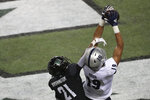 Nevada tight end Cole Turner (19) pulls in a touchdown catch in the end zone over Hawaii defensive back Michael Washington (21) during the first half of an NCAA college football game Saturday, Nov. 28, 2020, in Honolulu. (AP Photo/Marco Garcia)